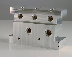 Aluminum block created in our AS9100 certified machine shop